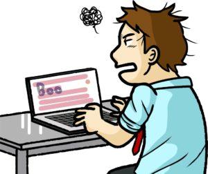 パソコンの前でイライラする人